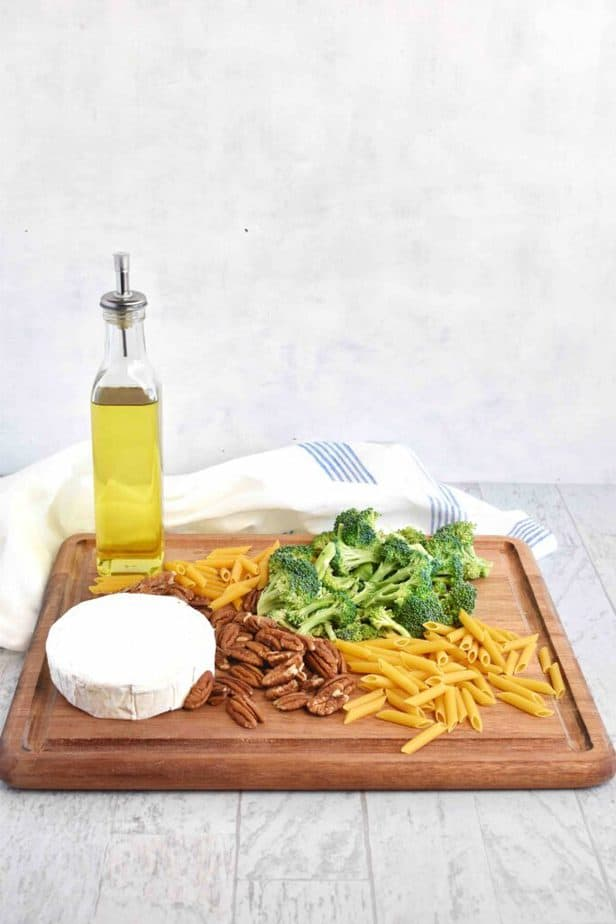 broccoli brie pasta ingredients sitting on cutting board