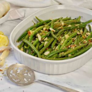 green beans on marble top in white baking dish
